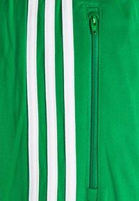adidas Originals - ADICOLOR CLASSICS FIREBIRD PRIMEBLUE TRACK PANTS - Tracksuit bottoms - green - 2
