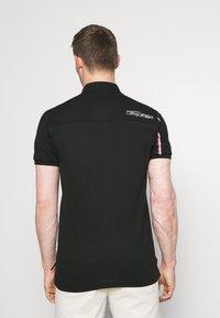 Tommy Hilfiger - SIGNATURE ZIP - Polo shirt - black - 2