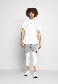 SQUATWOLF - WARRIOR SHORTS - Sports shorts - grey - 1