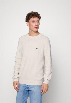 Stickad tröja - naturel clair