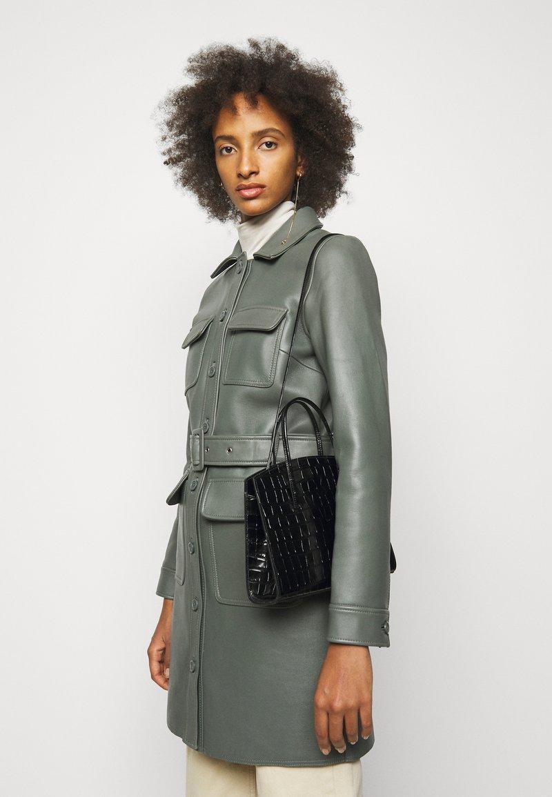 Little Liffner - MINIMAL MINI TOTE - Handbag - black