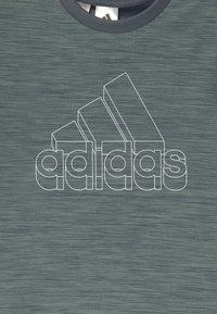 adidas Performance - Print T-shirt - dark green/white - 2