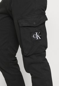 Calvin Klein Jeans - WASHED PANT - Cargo trousers - black - 5