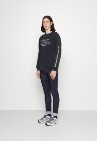 Replay - BRONNY AGED  - Jeans Tapered Fit - dark blue - 1