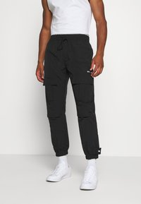 WRSTBHVR - TROUSER HYDRO UNISEX - Cargo trousers - black - 0