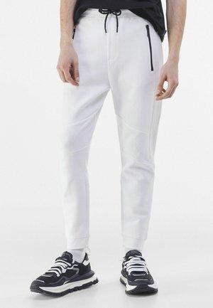 Träningsbyxor - white
