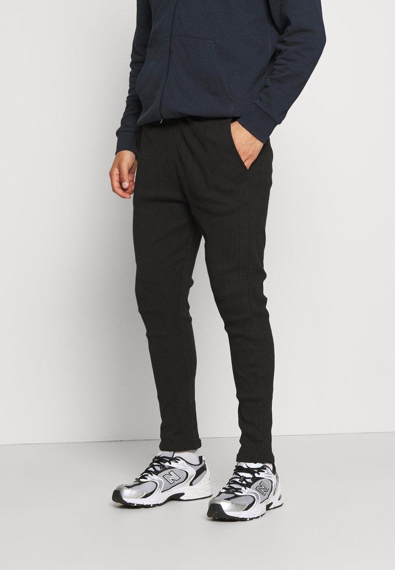 Nominal - REACT TROUSERS - Kalhoty - black