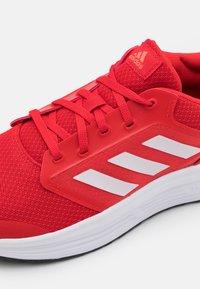 adidas Performance - GALAXY  - Zapatillas de running neutras - vivid red/footwear white/solar red - 5