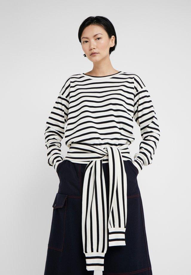 Långärmad tröja - ivoire/noir