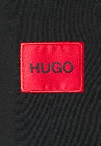 HUGO - DICHIBI REDLABEL - Tracksuit bottoms - black - 2