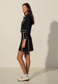 sandro - EUDINE - Mini skirt - noir - 1