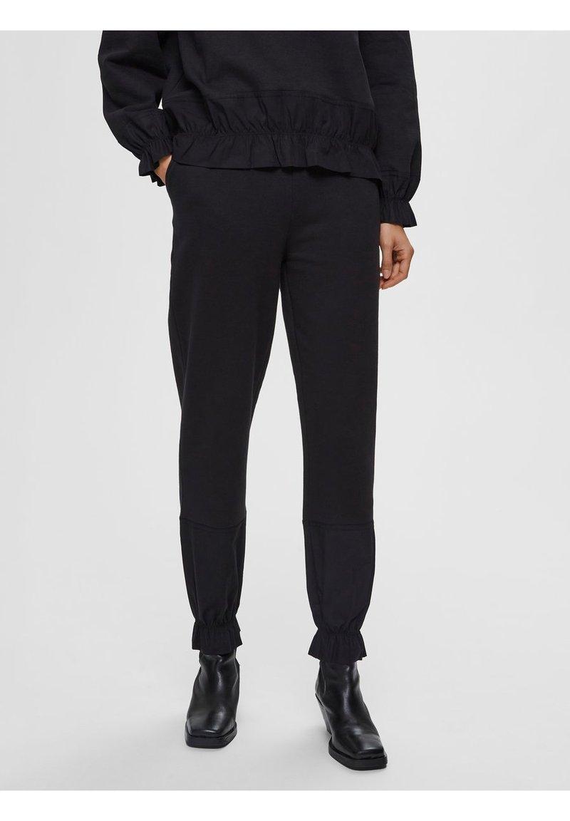 Selected Femme - Tracksuit bottoms - black