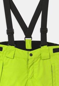 Reima - WINTER TAKEOFF UNISEX - Zimní kalhoty - lime green - 3