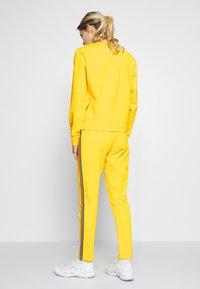 Bogner Fire + Ice - THEA - Spodnie treningowe - yellow - 2