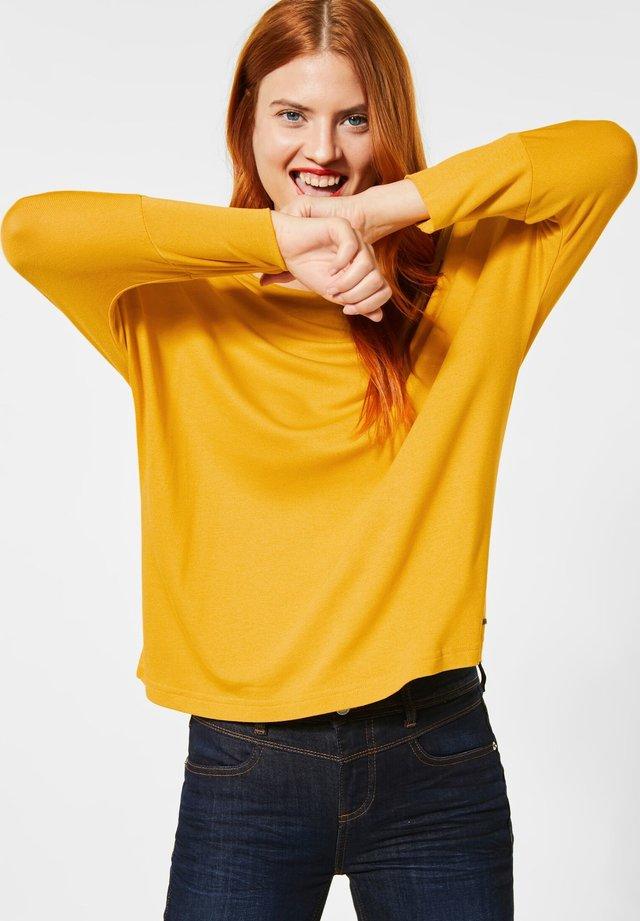 Longsleeve - gelb