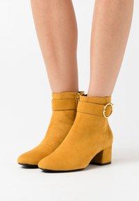 s.Oliver - Classic ankle boots - saffron - 0
