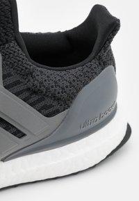 adidas Performance - ULTRABOOST DNA UNISEX - Trainers - core black/iron metallic/carbon - 5