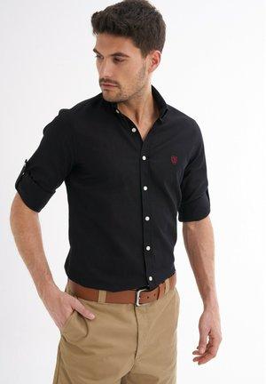 RIC - Shirt - schwarz