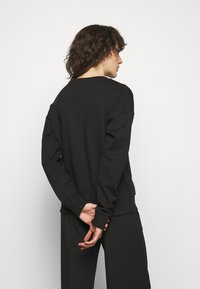 HUGO - NAKIRA - Sweatshirt - black - 2