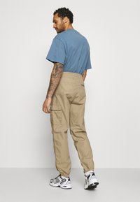 Carhartt WIP - JOGGER COLUMBIA - Cargo trousers - sand - 2