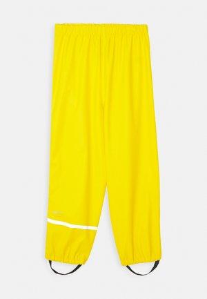 RAINWEAR PANTS SOLID UNISEX - Rain trousers - yellow