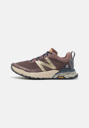 HIERRO - Trail running shoes - brown