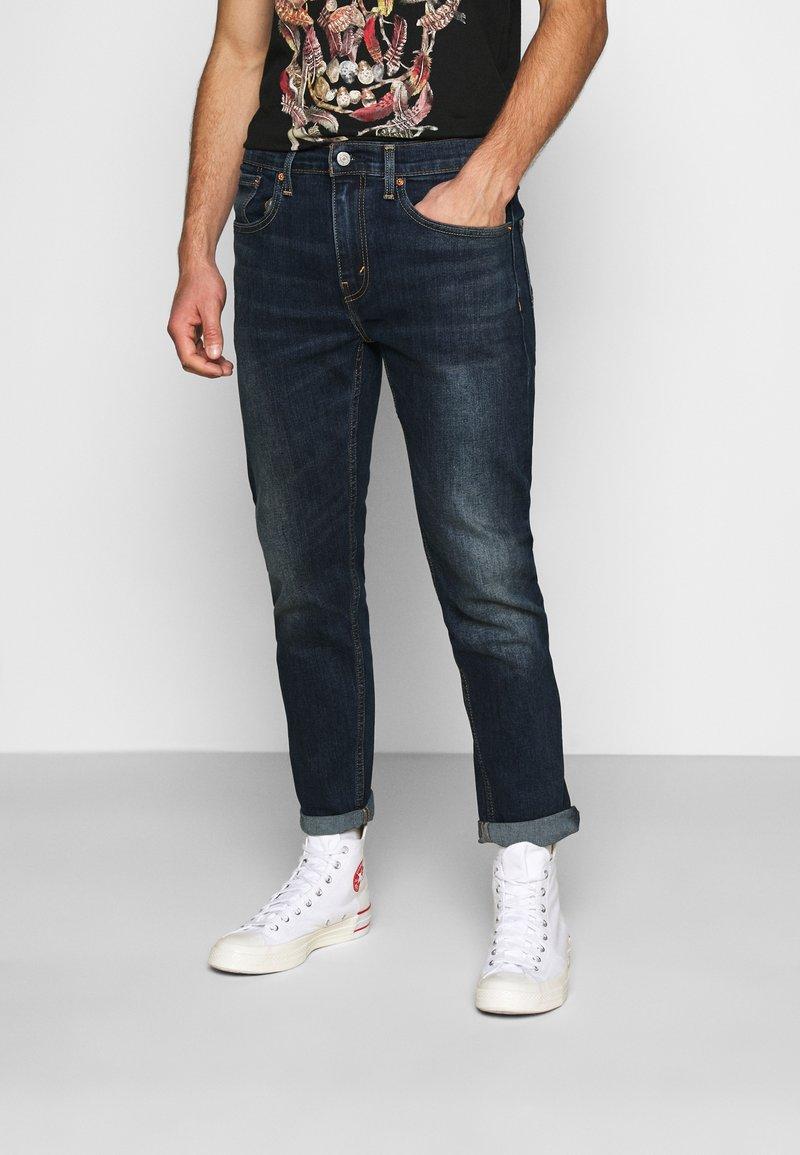 Levi's® - 502™ TAPER HI BALL - Jeans Tapered Fit - med indigo