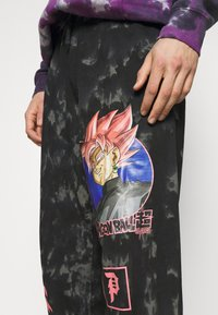 Primitive - GOKU WASHED - Pantaloni sportivi - black - 5