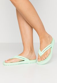 Crocs - CROCBAND - Pool shoes - neo mint - 0