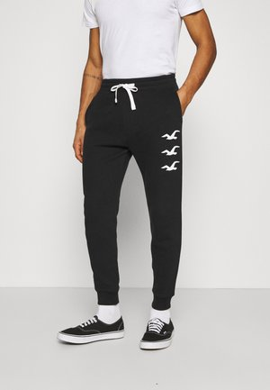 ICONIC PRINT JOGGER - Tracksuit bottoms - black stack gull