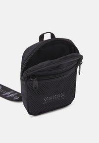 Urban Classics - SMALL CROSSBODY BAG UNISEX - Across body bag - black - 2