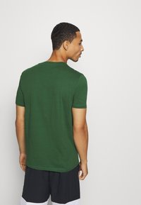 Champion - LEGACY CREWNECK - Camiseta básica - dark green - 2