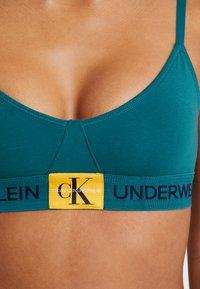 Calvin Klein Underwear - MONOGRAM UNLINED TRIANGLE - Bustier - dark green/orange - 6