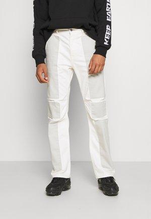 PATCHWORK GRUNGE - Straight leg jeans - blue