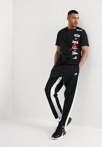 Nike Sportswear - AIR PANT - Træningsbukser - black/sail - 1