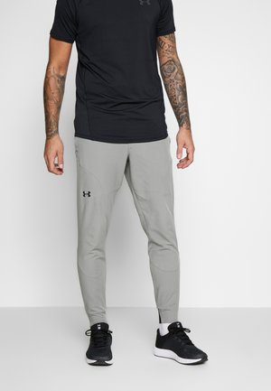 UA FLEX WOVEN JOGGERS - Tracksuit bottoms - gravity green/black