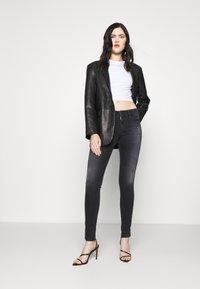 Diesel - SLANDY - Jeans Skinny Fit - dark grey - 1
