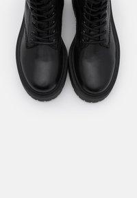 Bianco - Platform ankle boots - black - 5