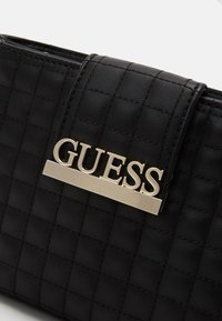 Guess - MATRIX ELITE CROSSBODY - Umhängetasche - black - 4