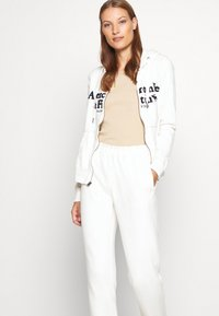 Abercrombie & Fitch - LOGO JOGGER - Tracksuit bottoms - white - 4