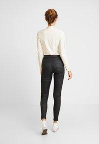 Topshop - COATED JONI - Pantalones - black - 2