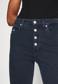 Calvin Klein Jeans - HIGH RISE SUPER SKINNY - Jeans Skinny Fit - dark blue denim - 7