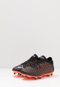 Puma - FUTURE 6.4 FG/AG - Voetbalschoenen met kunststof noppen - black/white/orange - 2