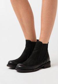 Felmini - COOPER - Kotníkové boty - morat black - 0