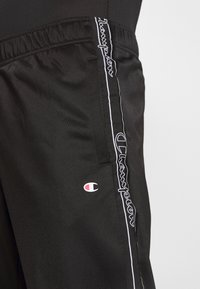 Champion - LEGACY TAPE CUFF PANTS - Tracksuit bottoms - black - 4