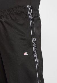 Champion - LEGACY TAPE CUFF PANTS - Pantalon de survêtement - black - 4