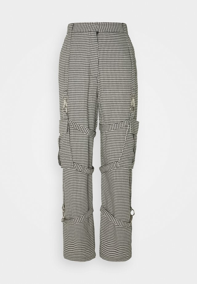 HOUNDSTOOTH COMBATS STRAPPED POCKETS - Trousers - black/white