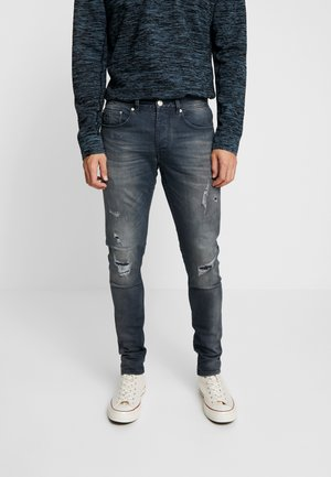 EGO AGAR - Slim fit jeans - dark blue denim