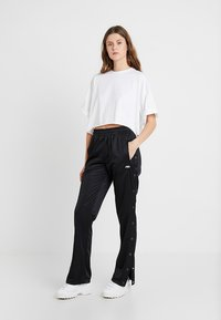 Fila Tall - GERALYN TRACK PANTS - Tracksuit bottoms - black - 1