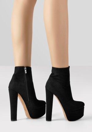 High heeled ankle boots - mottled black